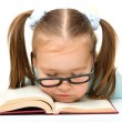 Stock Photo: Little girl is sleeping on book