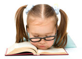 Little girl is sleeping on a book — Stock Photo