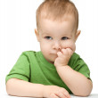 Pensive little boy support his head with hands — Stock Photo #8779468