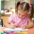 Cute little girl is drawing with felt-tip pen — Stock Photo #9426074