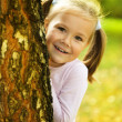 Cute little girl is playing hide and seek — Stock Photo #9426141