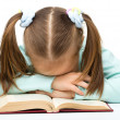 Cute little girl is sleeping on a book — Stock Photo #9426695