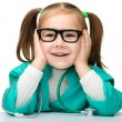 Little girl is playing doctor with stethoscope — Stock Photo