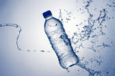 Bottle Water and Splash — Stock Photo