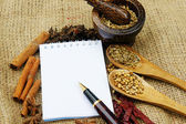 Note book and herb — Stockfoto
