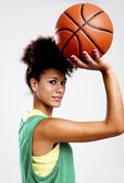 Beautiful woman with basketball — Стоковое фото