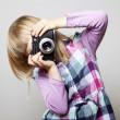 Little girl with camera — Stock Photo #9081038