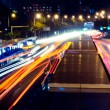 Stockfoto: Busy big city traffic trail night