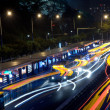 Busy big city traffic trail night — Stock Photo