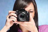Girl wit camera — Stock Photo