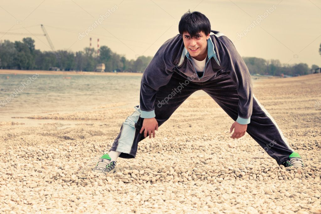 Young man exercise by the river spring day  Stock Photo #10066532