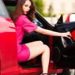 Stylish woman in red car — Stock Photo #10503871