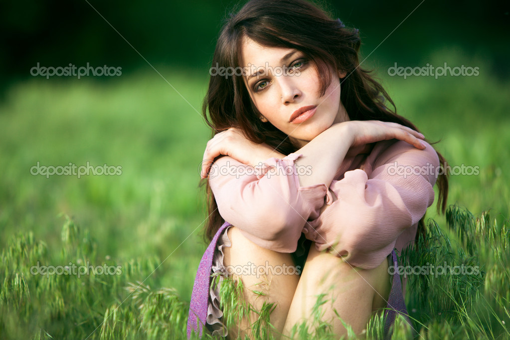 Young natural looking woman relaxing in nature summer day — Stock Photo #10503742
