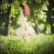 Redhead woman in the wood — Stock Photo #10718839