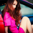 Stylish woman in red car - Stock Photo