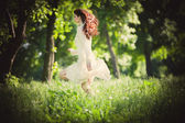 Redhead woman in the wood — Stock Photo