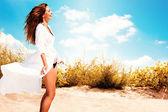 Smiling woman on beach — Stock Photo