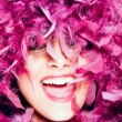 Stock Photo: Cheerful woman in pink feathers