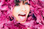 Jolly woman in plumage — Stock Photo