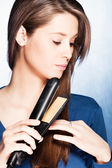 Hair straightener iron — Stock Photo