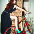 Woman on bicycle — Stock Photo #9682945