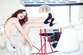 Fashion model in glittering dress — Stock Photo