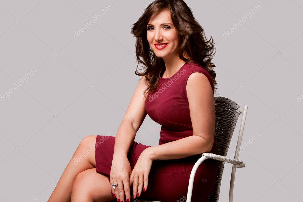 Beautiful smiling elegant mature woman studio shot