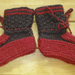 Hand knitted baby booties — Stock Photo #9137081