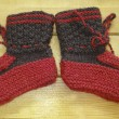 Stock Photo: Hand knitted baby booties