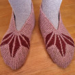 Hand knitted female slippers - Stock Photo