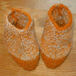 Hand knitted baby booties - Stock Photo
