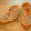 Hand knitted baby booties — Stock Photo #9428638
