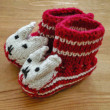 Hand knitted baby booties — Stock Photo