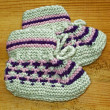 Hand knitted baby booties — Stock Photo #9428752