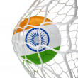 Indian soccer ball inside the net - Stock Photo