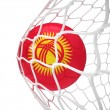Kyrgyzstan soccer ball inside the net — Stock Photo