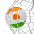 Niger soccer ball inside the net - Stock Photo
