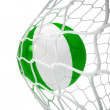 Nigerian soccer ball inside the net — Stock Photo
