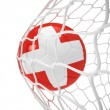 Swiss soccer ball inside the net — Stock Photo