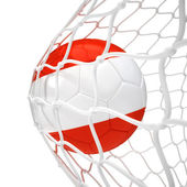 Rakouský fotbalový míč uvnitř sítě — Stock fotografie