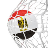 Egyptian soccer ball inside the net — Stock Photo