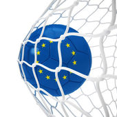 European soccer ball inside the net — Stock Photo