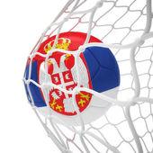 Serbian soccer ball inside the net — Stock Photo