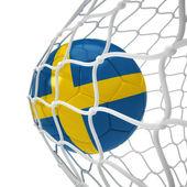 Swedish soccer ball inside the net — Stock Photo