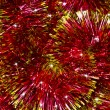 Red Christmas tinsel garland — Foto Stock