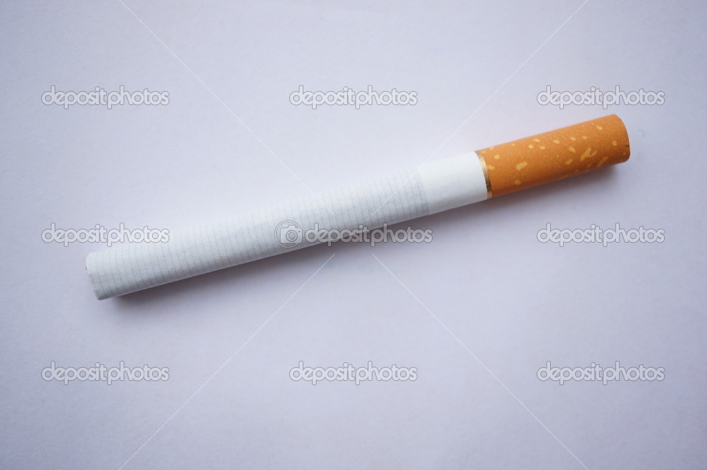 A cigarette against a white background — Stock Photo #8620191