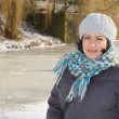 Woman by a frozen lake — Stock Photo
