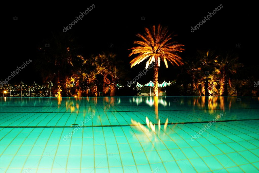 Swimming pool at night  in exclusive hotel-Mahdia,Tunisia.   Stock Photo #9959060