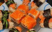 Суши и роллы на тарелке — Stock Photo