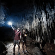 Cave. Young couple — Stock Photo